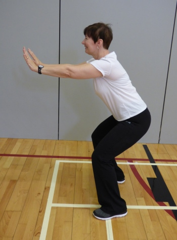 Image of Parkinsons exercise class participant doing physio to improve strength and posture